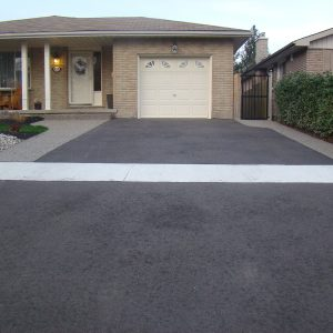 asphalt wtih exposed aggregate border and landscaping